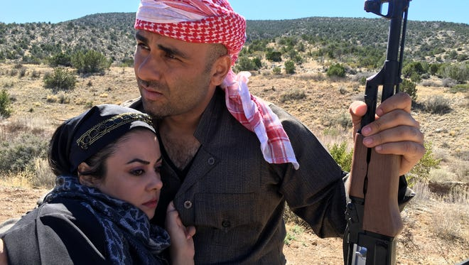 """Hussain Ahmed and another actress from the film """"The Last Hope"""" shoot a scene in the mountains of Alamogordo."""