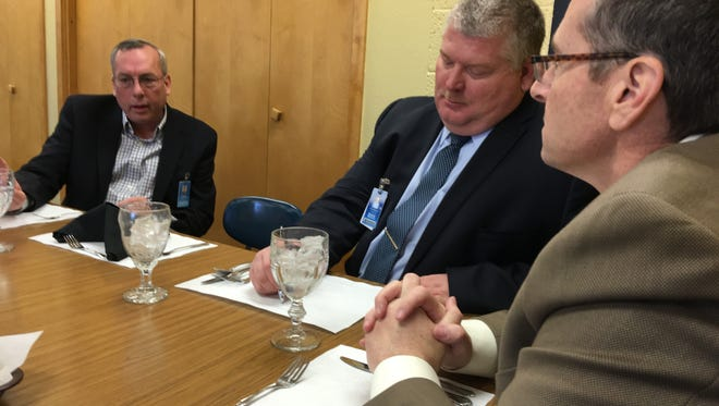 Board president Greg Cory, left, Supt. George Bickert, right, and RHS principal Cody Patterson, center, wait for lunch in the TeePee Lounge as they talk school business.