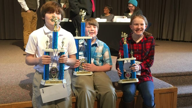 The top three West Tennessee Spelling Bee winners, Jude Taylor, left, Elijah Brewer, middle, and Blair Mercer, right, pose for pictures after the March regional competition.