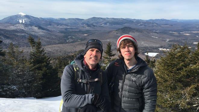 Dave Clark (left) and son Matt  summit one of the Aridondack mountains Saturday.