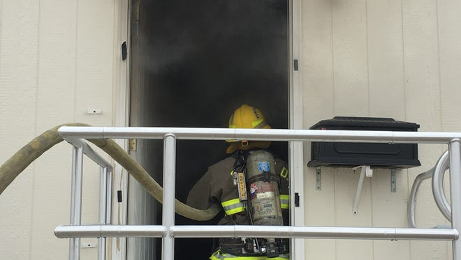 Firefighters enter a home Monday morning on 1785 10th St. in Silver Springs in response to a report of a fire. One person died in the fire, and the cause was still under investigation.