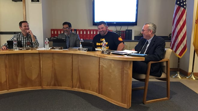"""Board member Shane Holder shows off his new t-shirt from a recent conference that says """"I New Mexico Public Schools"""""""
