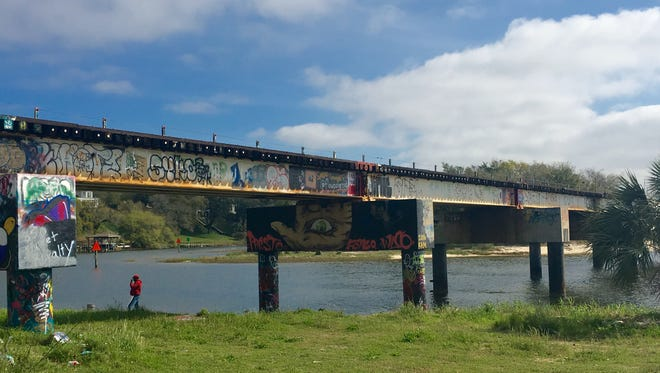 The Graffiti bridge and grassy area surrounding it are often littered with paint remnants and trash from the high volume of visitors each day. A group of friends will host an official clean up of the area this Saturday, with free food offered at the Shaka Bar after the event.