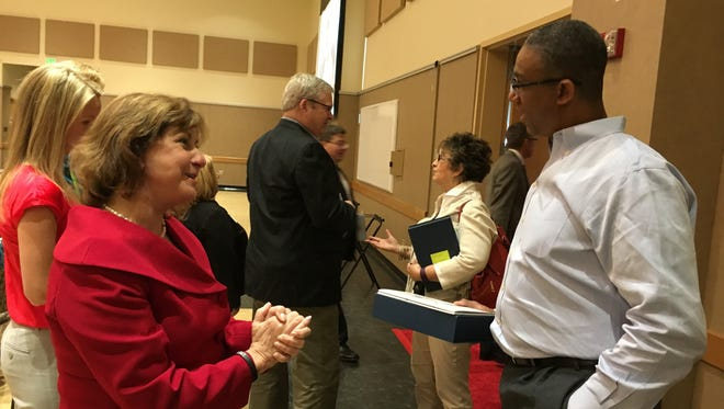 Kathleen Momme, executive director of the United Way of the Lower Eastern Shore, talks to Davis Jean-Louis of Interstate Container of Cambridge at the 71st Annual Meeting Friday at the University of Maryland Eastern Shore.