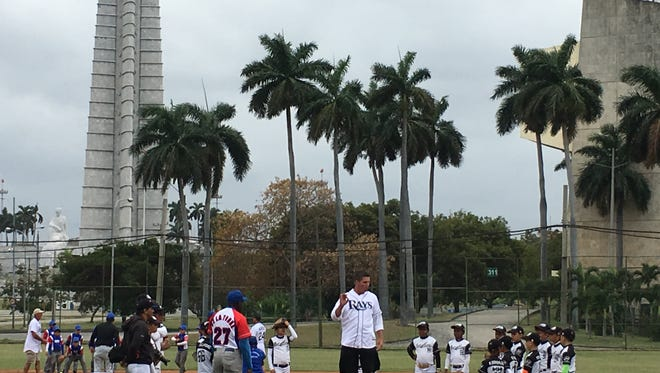 Distinguished ambassadors and Rays coaches shares tips at a clinic for 9- and 10-year-olds at a field across from Plaza de la Revolucion.