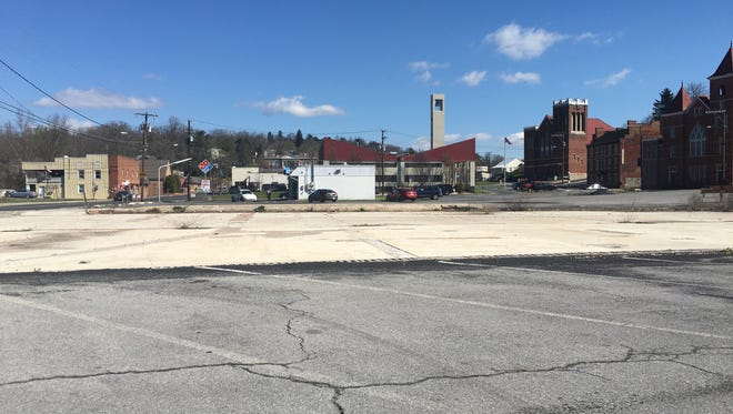 An empty lot, owned by DuPont Community Credit Union, at the intersection of Central Avenue and Pump Street in Staunton. The lot is expected to house a new building for the credit union.