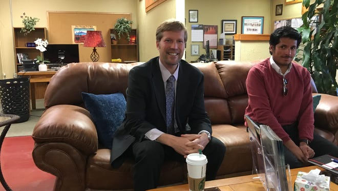 State Auditor Timothy Keller (left) and his operations administrator Aaron Nieto visited the News to discuss new rules for governmental outside auditors this year.