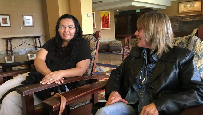 Janice Merino (left), a suicide prevention worker in Mescalero, and Shirley Estes of whispering-wind.org discuss plans for a suicide awareness concert planned for April 16.