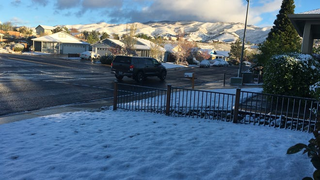 Snow fell Thursday morning in higher elevations around Reno.