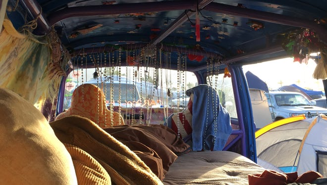 Jason Lopez and his friends made their camp in a 1969 hippie van.