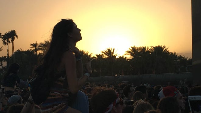 A fan sits on another's shoulders during Of Monsters and Men's set on the first Friday of Coachella 2016.