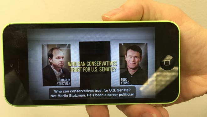 An ad from Rep. Todd Young challenges the conservative credentials of GOP rival Marlin Stutzman before the May 3 Senate primary.