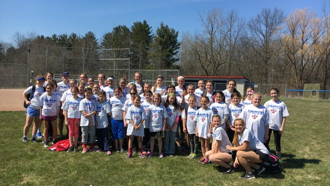 The participants of the St. Clair softball camp pose for a photo Saturday with the St. Clair High School softball team