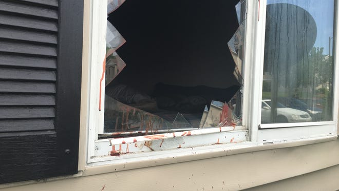 Blood was still on a Bedford Park apartment window after a man broke through the glass while escaping a fire.