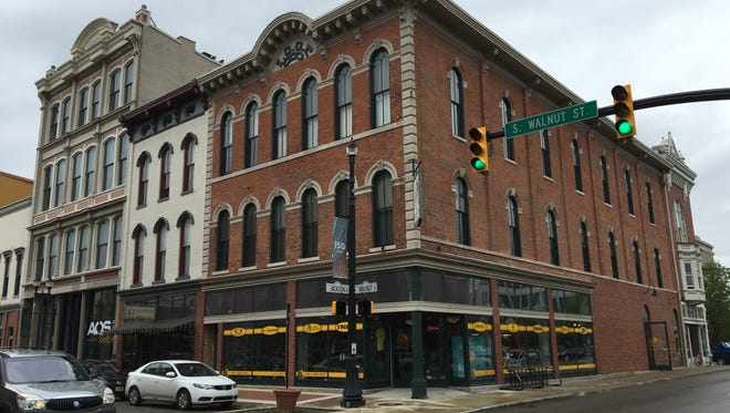 The building with two storefronts in the 100 block of South Walnut Street that is up for sale.