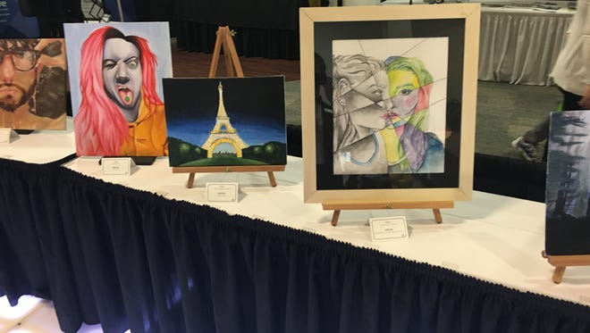 Visitors to the Wausau Region Chamber of Commerce Business Expo voted on student art. Winners received up to a $1,500 scholarship.
