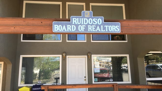 A former executive director of the Ruidoso Board of Realtors was indicted Monday on 197 counts of embezzlement.