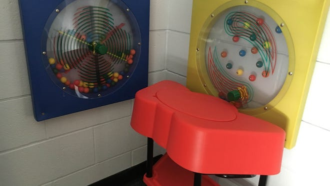 Interactive toys line the walls in one cottage at the Youth Opportunity Center. The center has started a new program for youths with intellectual or developmental disabilities.
