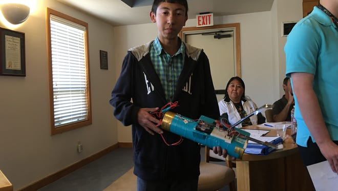 RHS student Jose Ramirez, a member of the school's MESA club, displays a set of motorized tongs he built as part of an engineering project.