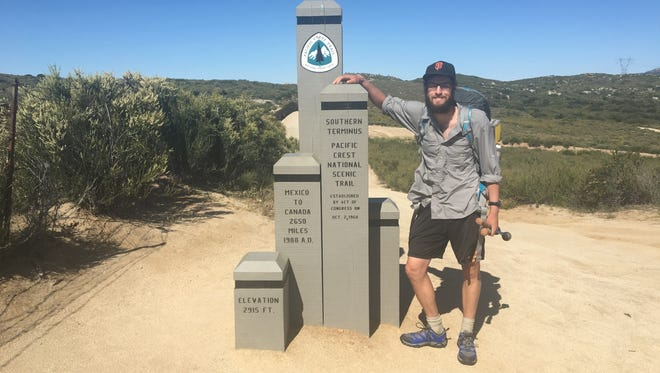 Jeff Garmire poses at the southern terminus of the Pacific Crest Trail. The former Salem resident it attempting to hike 7,500 miles in one year.