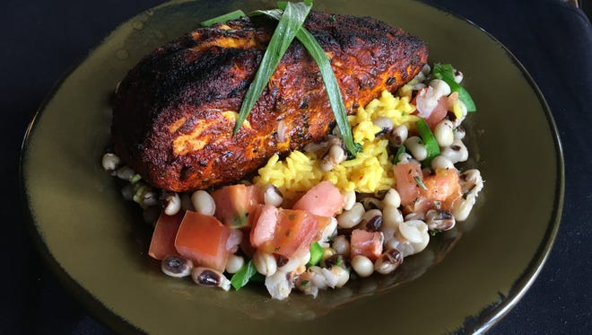 Blackened maui with yellow rice with black-eye peas ragut.