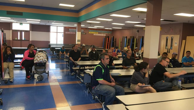 About 30 parents met with state youth soccer officials at White Mountain Elementary school Monday to hear advice on how to make the local league run better.
