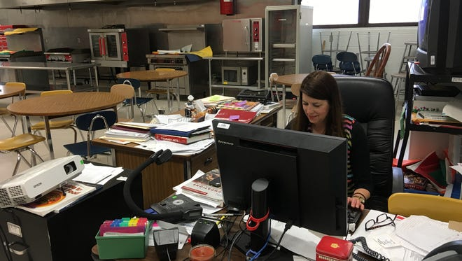 Julie Rigsby checks her email between classes in one of her last weeks as head of the Ruidoso High School culinary arts program and the TePee Lounge.