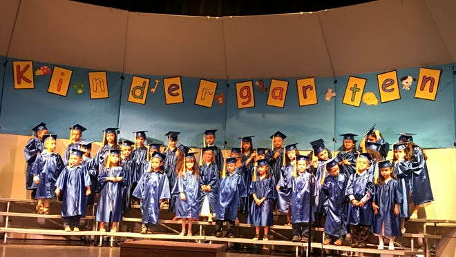 Today was Nob Hill Early Childhood Center's commencement day at the Ruidoso High School  Performing Arts Center. Here the two dual language classes share the stage to sing Spanish songs and receive applause from admiring friends and relatives.