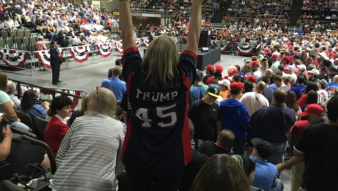 The crowd displays its enthusiasm at the Trump rally in Selland Arena in Fresno.