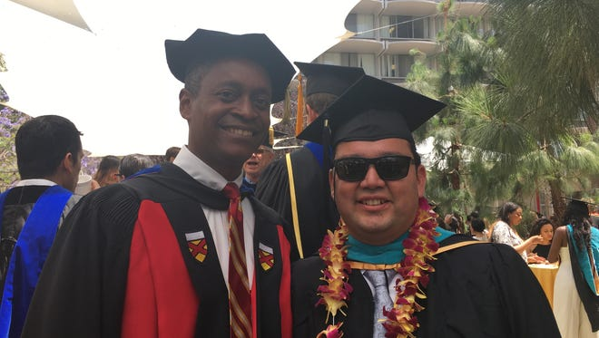 Coachella Mayor Steven Hernandez graduated from the USC Price School of Public Policy with his master's in public administration on May 13, 2016. Here, he is pictured with Professor Raphael Bostic, Chair of the Department of Governance, Management and Public Policy.