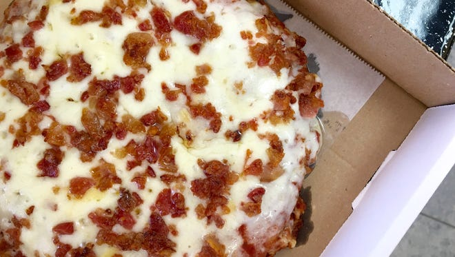 A Cuban-style pizza with bacon from El Tinajon in Cape Coral.