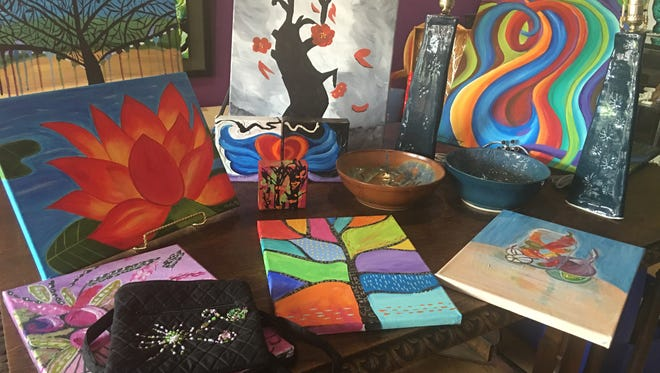 Some of the artwork that has been donated for a silent auction that will be held at Studio 116 this weekend to benefit a local family is featured.