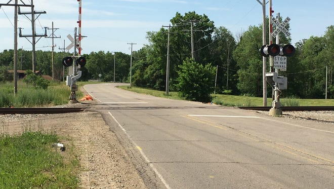 The 15 Mile Road railroad crossing in Marshall Township.