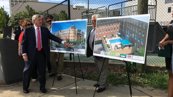Mayor Todd Strange shows renderings of a 114-room Staybridge Suites that will be build at 301 Bibb St. It should be finished in about a year.