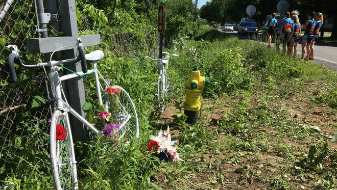 Five white-painted ghost bikes were placed June 8, 2016 at the scene of a crash on the 5500 block of North Westnedge Avenue north of Kalamazoo, where five cyclists died on June 7, 2016.