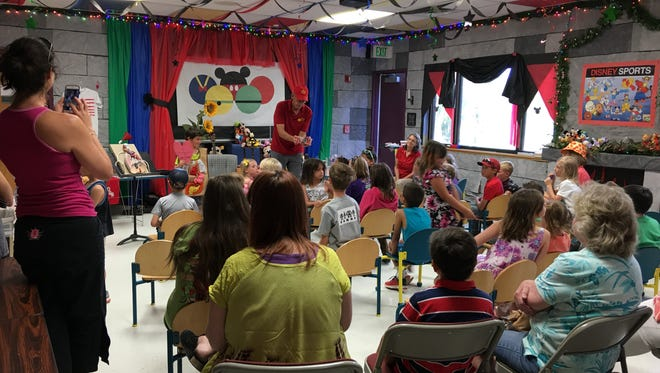 Curious Chris engages a crowd of 56 at the Ruidoso Library this week as they explore the mysteries of the human heart among other scientific phenomena.