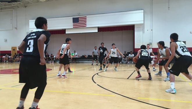 Two teams play during pool play at the Native American Basketball Invitational.