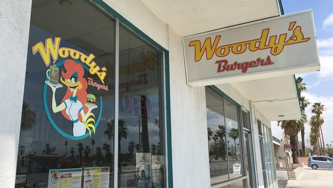 The sign at the old location for Woody's Burgers.