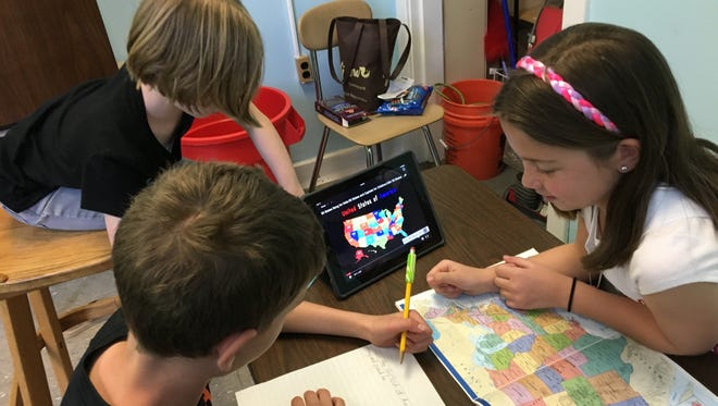 Three Stoy students combine technological and traditional materials in their hybrid classroom.
