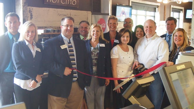 Attending the Norcino Deli and Charcuterie's ribbon cutting are, from left: Eric Gurholt, Huberty CPAs & Trusted Advisors; Megan Acheson, Lakeland Care District; Steve Leaman, Horicon Bank; Patrick Friedel, Mountain Dog Media; Joan Pinch, Holiday Inn; Jesee TeStroete, Fox Valley Savings Bank; Stephanie Peper, Norcino Deli & Charcuterie owner; Bob Boettcher, SEEK Careers/Staffing, Inc.; Kimberly Klaetsch, American Bank; Troy Peper, Norcino Deli & Charcuterie owner; David Thiel, Associated Bank; and Kim Schmitz, US Bank.