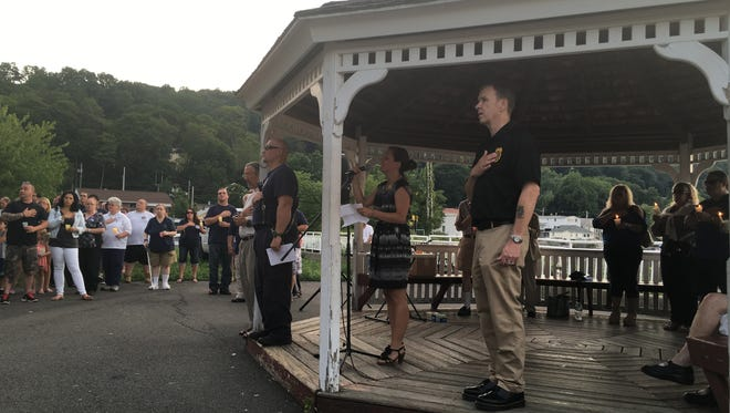 Piermont Fire Chief Daniel Goswick (far left) and Piermont Police Chief Michael O'Shea (far right) at Piermont's vigil for police officers killed in Baton Rouge and Dallas