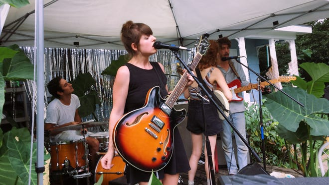 A band performs during a Sickband event, which is usually a house concert or festival.