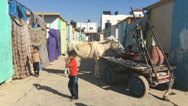 The Gaza neighborhood of Bet Hanoun hosts many families waiting for their homes to be rebuilt.