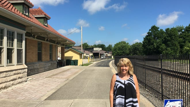 Angie Pool, CEO of Cardinal Greenways, stands outside the Wysor Street Depot, which serves as the offices for the greenway.