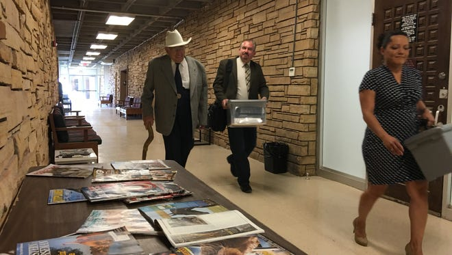 American Legion Post 79 Finance officer Gene Kurtz and attorney William Griffin arrive in court Tuesday for trial of the Post's lawsuit against its women's Auxiliary.