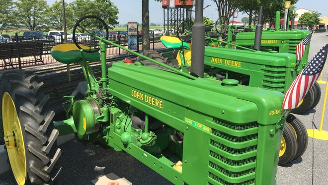 John Deere tractors line up on display at the Strasburg Rail Road in Pennsylvania.