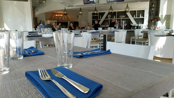 Ocean blues and seafoam  whites color the dining room at Salt on Mass Ave, 505 Massachusetts Ave. The restaurant opened Aug. 23, 2016.