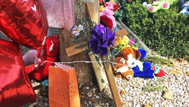 A memorial for a 10-year-old girl who police said was sexually assaulted, strangled then dismembered is seen at an Albuquerque, N.M., apartment building Thursday, Aug. 25, 2016. On the day the girl was going to celebrate her 10th birthday, she was found dead Wednesday in her family's apartment by Albuquerque police, her dismembered remains lying under a burning blanket. The girl's mother, 35-year-old Michelle Martens, her 31-year-old boyfriend, Fabian Gonzales, and his 31-year-old cousin, Jessica Kelley, are facing charges.