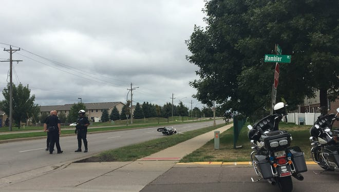 Officers discuss a pedestrian versus motorcycle accident near 85th and Lousie the morning of Saturday, Aug. 27.