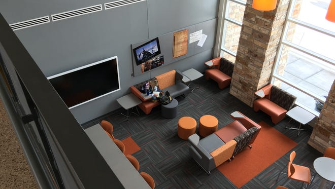 A two-story common space in the new Capital High School building serves as a media room, study area, presentation center and more.